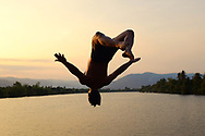A local man from the colonial town of Kampot in Cambodia is jumping in the Kampong Bay River.<br />