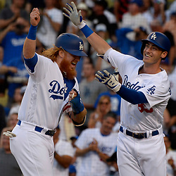 June 20, 2017 - Los Angeles, California, U.S. - Los Angeles Dodgers' Cody Bellinger celebrates a with teammate Justin Turner (10) after hitting a two run home run in the first inning of a Major League baseball game against the New York Mets at Dodger Stadium on Tuesday, June 20, 2017 in Los Angeles. (Photo by Keith Birmingham, Pasadena Star-News/SCNG) (Credit Image: © San Gabriel Valley Tribune via ZUMA Wire)