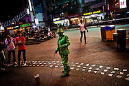 Green statue street performer in the center of Kuala Lumpur, Malaysia, Southeast Asia