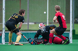 Southgate's Allan Dick makes an early save as Charlie Rookes and Beeston's Stephen Lawrence look on. Southgate v Beeston - Now: Pensions Men's Hockey League - Premier Division, Trent Park, London, UK on 15 November 2014. Photo: Simon Parker