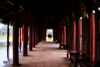 Two visitors in a doorway at the Imperial Citadel in Hue, Vietnam.