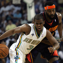 Chris Paul #3 of the New Orleans Hornets bumps into Baron Davis #5 of the Golden State Warriors in the first quarter of their NBA game on April 6, 2008 at the New Orleans Arena in New Orleans, Louisiana.