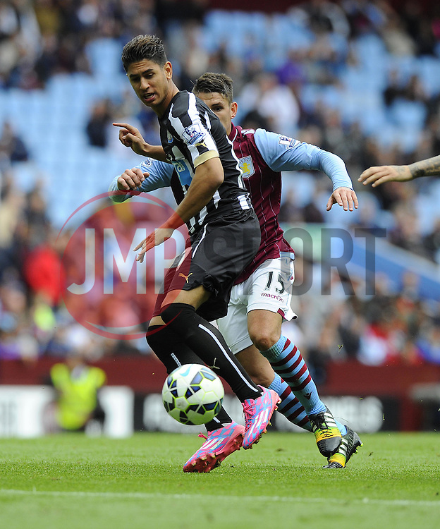 Newcastle United's Ayoze Perez evades the challenge of Aston Villa's Ashley Westwood - Photo mandatory by-line: Joe Meredith/JMP - Mobile: 07966 386802 23/08/2014 - SPORT - FOOTBALL - Birmingham - Villa Park - Aston Villa v Newcastle United - Barclays Premier League