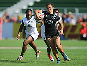 DUBAI, UNITED ARAB EMIRATES - Thursdays 30 November 2017, Theresa Fitzpatrick of New Zealand tries to get away from Zintle Mpupha and Veroeshka Grain of South Africa during HSBC Emirates Airline Dubai Rugby Sevens match between South Africa and New Zealand at The Sevens Stadium in Dubai.<br /> Photo by Roger Sedres/ImageSA