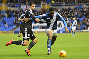 Brentford defender Maxime Colin attempts to tackle Birmingham City midfielder Viv Solomon-Otabor during the Sky Bet Championship match between Birmingham City and Brentford at St Andrews, Birmingham, England on 2 January 2016. Photo by Alan Franklin.