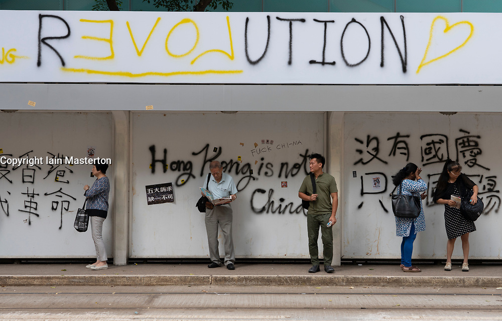 Hong Kong. 2 October 2019.  Many buildings and walls were vandalised and daubed with political slogans and anti-Chinese government and anti-police graffiti in Central and Wanchai districts by pro-democracy supporters on China's National Day on 1 October. Widespread clean-up operation is now underway. Graffiti on tram stop. Iain Masterton/Alamy Live News.