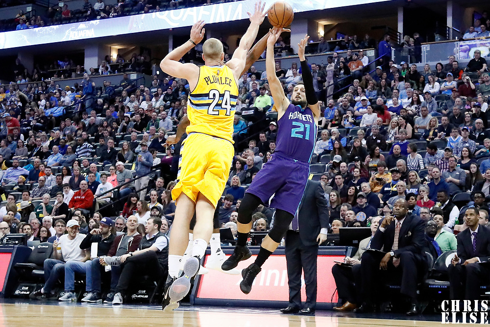 04 March 2017: Charlotte Hornets guard Marco Belinelli (21) takes a jump shot over Denver Nuggets center Mason Plumlee (24) during the Charlotte Hornets 112-102 victory over the Denver Nuggets, at the Pepsi Center, Denver, Colorado, USA.