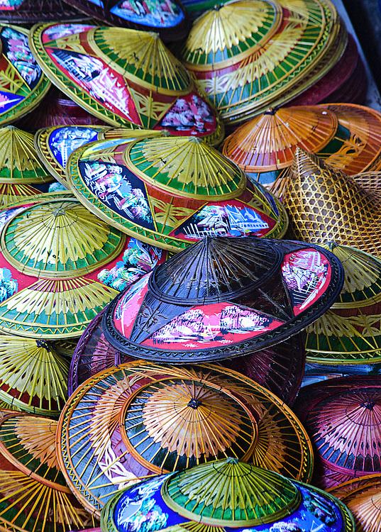 Hats for sale at the Damnoen Saduak Floating Market - Bangkok, Thailand.