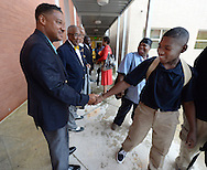 August , 2013 - Atlanta: Dr. Joseph Saulsbury greets a smiling Steven Conyers  on the first day of school at B.E.S.T Academy (Business Engineering Science Technology) on Wednesday, August 7, 2013.   Over 80 members of the 100 Black Men of Atlanta greeted the boys and their parents as they arrived at school.  The boys were inspired by Young to become leaders in their community.  Young spoke to boys in  middle  and high School.  The school is an all male school.  Today was the first day of school for students in Atlanta and Cobb County. ©Johnny Crawford