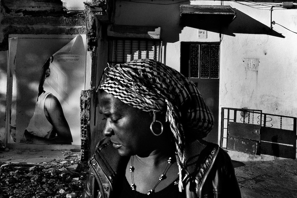 Cape Verde-born, Portuguese Emilia Garcia, 46, who also has her house scheduled to be destroyed, is seen at Santa Filomena neighborhood, in Amadora, Portugal, on November 13, 2012. According to local authorities, the Santa Filomena neighborhood, a predominantly area which hosts Cape Verde immigrants, is an illegally occupied area scheduled to be totally demolished, as part of local Special Rehousing Program (PER), and those families whose are not enrolled in the PER program, will have to find out alternative solutions by themselves. Near 250 houses still remain there. Photo by Mauricio Lima for The New York Times
