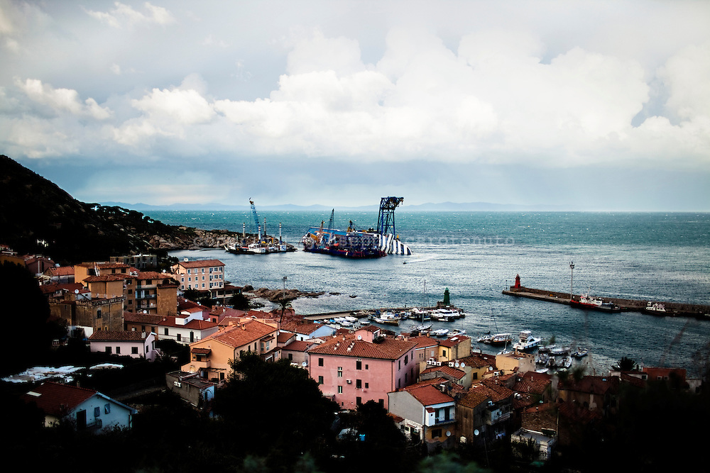 "Italy - Isola del giglio. The wreck of the ship ""Costa Concordia"" lies on the coast of Isola del Giglio. .About a year after the tragedy (13 January 2011), continue the removal of the ship entrusted to the consortium Italian-American Micoperi - Titan."