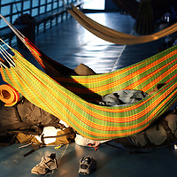 Backpackers sleeping in hammocks on a passenger ferry heading towards Iquitos