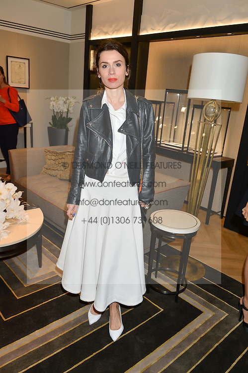 LARA BOHINC at a private view of photographs by Astrid Munoz entitled Unbridled Synchrony hosted by  Jaeger-LeCoultre at their boutique at 13 Old Bond Street, London on 13th July 2015.