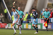 Huddersfield Town defender Mark Hudson (5)  is booked and receives a caution and a yellow card  during the Sky Bet Championship match between Huddersfield Town and Sheffield Wednesday at the John Smiths Stadium, Huddersfield, England on 2 April 2016. Photo by Simon Davies.