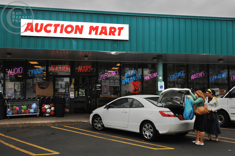 Here, an exterior image of the Auction Mart (75 Route 59, Monsey, NY) store owned by Joseph and Mirel Kizelnik (845-352-3725) (not pictured). The couple spoke with The NY Times about the Wal-Mart and why they are opposed to it, from a business and a religious standpoint..---.Thursday, June 15, 2007 - Monsey, NY - Orthodox and Hasidic communities oppose Wal-Mart - Religious leaders, business owners and residents in this heavily Orthodox Jewish community in Rockland County have organized to wage a quiet, yet strong opposition to the construction of a Wal-Mart Super Center. In addition to concerns about increased traffic on Route 59, a two-lane state highway with a Main Street feel, the opponents see Wal-Mart as an unwieldy anchor of modernity in an otherwise insulated world steeped in religious tradition...Credit: Rob Bennett for The New York Times