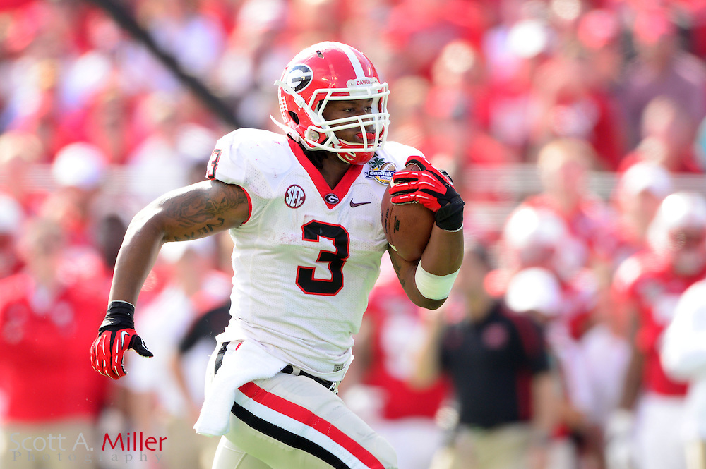 Georgia Bulldogs running back Todd Gurley (3) scores during the Bulldogs 45-31 win over the Nebraska Cornhuskers in the Capital One Bowl at the Florida Citrus Bowl on Jan 1, 2013 in Orlando, Florida. ..©2012 Scott A. Miller..