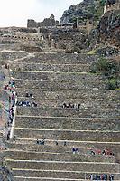 Ollantaytambo, Peru - July 16, 2013: tourists at Ollantaytambo, Incas ruins in the peruvian Andes at Cuzco Peru on July 16 2013