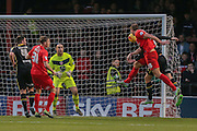York City defender Dave Winfield  scores with a header  during the Sky Bet League 2 match between York City and Morecambe at Bootham Crescent, York, England on 19 December 2015. Photo by Simon Davies.