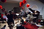 Dave Enos, Larry Koonse, Tom Zink, Chris Wabich during a performance at Hoson House on Sunday, December 4, 2016 in Tustin, California.