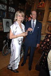 HRH The DUKE OF KENT and artist BARBARA KACZMAROWSKA HAMILTON at a private view of portraits, Still-Lives and Statues by artists Barbara Kaczmarowska Hamilton and Simon Boudard held at Partridge Fine Art Ltd, New Bond Street, London on 16th May 2007.<br />