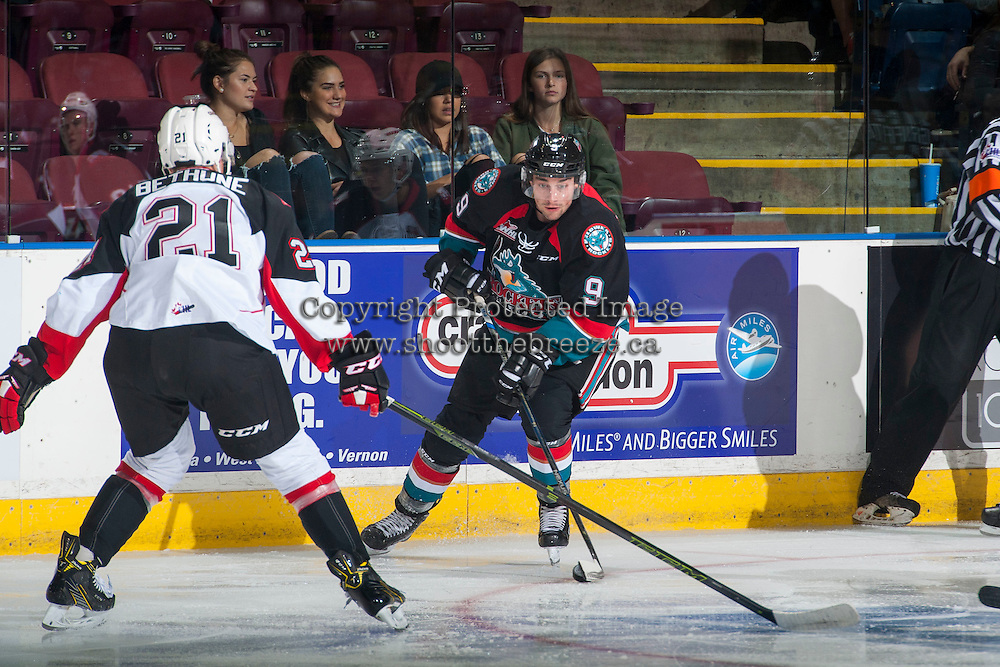 KELOWNA, CANADA - SEPTEMBER 28: Jared Bethune #21 of Prince George Cougars checks Tanner Wishnowski #9 of Kelowna Rockets as he skates with the puck on September 28, 2016 at Prospera Place in Kelowna, British Columbia, Canada.  (Photo by Marissa Baecker/Shoot the Breeze)  *** Local Caption *** Jared Bethune; Tanner Wishnowski;