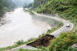3rd July 2013. On the 16th and 17th June, the South West monsoon came earlier than expected with particularly heavy rain fall in the North Indian Himalayan state of Uttarakhand, the level of destruction is only just being realised as previously inaccessible areas are just being reached. Here a road has collapsed. MANDATORY CREDIT: © Sam Spickett/RedR India, under license to London News Pictures.