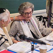 CHEVY CHASE, MD -MAY14: (L-R)Charlotte Markowitz, 85, congratulates Sy Laufe, 90, after Sy read from the Torah at their Bat-Mitzvah ceremony, at the Five Star Residences in Chevy Chase, Maryland, May 14, 2016. The women who were unable to have a Bat-Mitzvah ceremony at the traditional age of 13 because they were girls, are now finally able to celebrate this traditional Jewish coming of age ceremony. (Photo by Evelyn Hockstein/For The Washington Post)