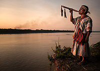 PUERTO MALDONADO, PERU - CIRCA SEPTEMBER 2019: Portrait of a Shaman of the tribe Machiguenga in the Peruvian Amazon.