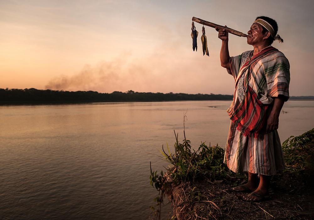 PUERTO MALDONADO, PERU - CIRCA SEPTEMBER 2019: Portrait of a Shaman of the tribe Machiguenga in the Peruvian Amazon.