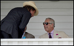Image ©Licensed to i-Images Picture Agency. 26/07/2014. Windsor, United Kingdom. Prince Charles in the Royal Box  at half time during the Coronation Cup at Guards Polo Club, Windsor Great Park Picture by Andrew Parsons / i-Images
