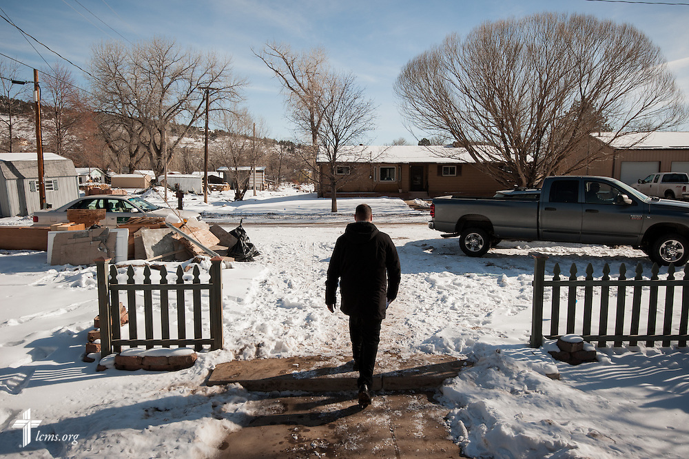 The Rev. Michael W. Meyer, manager of LCMS Disaster Response, leaves a flood-damaged house in Lyons, Colo., on Wednesday, Jan. 8, 2014. LCMS Communications/Erik M. Lunsford