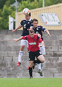 Dundee's Kyle Benedictus and trialist Ewan Moyes outjump Southend United's Neil Harris - Dundee v Southend United - East Fife Tournament at New Bayview<br /> <br /> &copy; David Young<br /> <br /> <br /> http://www.davidyoungphoto.co.uk