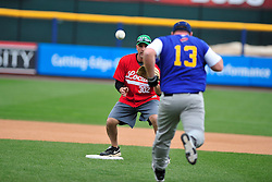 4/26/2014 Allentown, PA Firefighter Brennen Harding sets up for the ball at second base to tag out Officer Andy Hausman. Police Officers and Firefighters from the City of Allentown take to the field at Coca-Cola Park Saturday afternoon for a 90-minute softball game as part of Hero's Night, an IronPigs special event to promote local emergency responders. Express-Times Photo | CHRIS POST