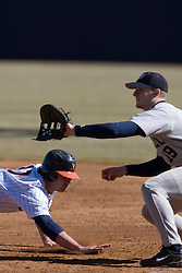 Virginia Cavaliers infielder Jeremy Farrell (17) dives to first base during a Bucknell pickoff attempt.  The Virginia Cavaliers Baseball Team defeated the Bucknell University Bisons 3-0 in the first game of a doubleheader at Davenport Field in Charlottesville, VA on February 24, 2007.
