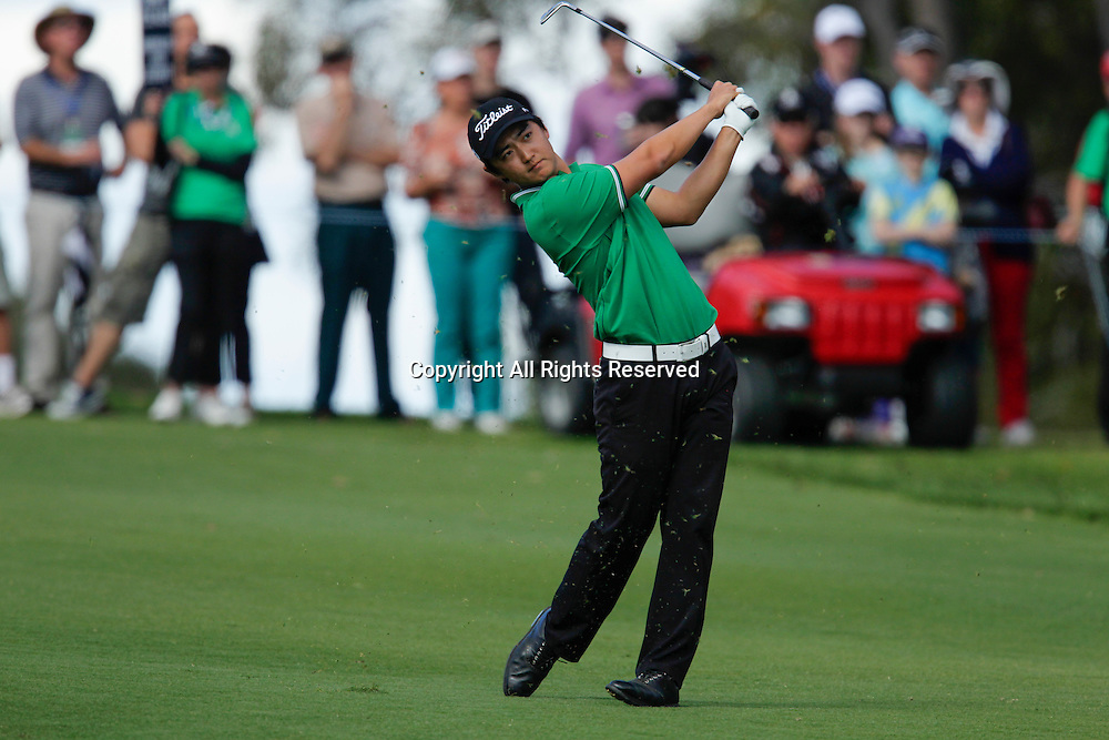 20.10.2013 Perth, Australia. Jin Jeong (KOR) plays an approach shot in the play off against Ross Fisher (ENG) during the final day of the ISPS Handa Perth International Golf Championship from the Lake Karrinyup Country Club.