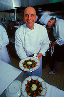 Bernard Loiseau at Hotel-Restaurant C(TM)te d'Or, Saulieu, Burgundy, 1999 - with his signature dish of fried frog legs with purees of garlic and parsley.© Owen Franken