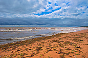 Low tide and red sandstone beach along the Northumberland Strait<br />Tignnish Shore<br />Prince Edward Island<br />Canada