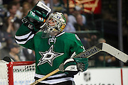 DALLAS, TX - OCTOBER 17:  Dan Ellis #30 of the Dallas Stars drinks from a Gatorade bottle against the San Jose Sharks on October 17, 2013 at the American Airlines Center in Dallas, Texas.  (Photo by Cooper Neill/Getty Images) *** Local Caption *** Dan Ellis