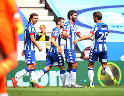 Will Grigg of Wigan Athletic (C) celebrates scoring his sides first goal - Mandatory by-line: Jack Phillips/JMP - 13/08/2016 - FOOTBALL - DW Stadium - Wigan, England - Wigan Athletic v Blackburn Rovers - EFL Sky Bet Championship