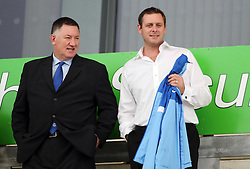 Peterborough United's chief executive Bob Symns and chairman Darragh MacAnthony  - Photo mandatory by-line: Joe Dent/JMP - Tel: Mobile: 07966 386802 06/08/2013 - SPORT - FOOTBALL - Weston Homes Community Stadium - Colchester -  Colchester United V Peterborough United - Capital One Cup - First Round