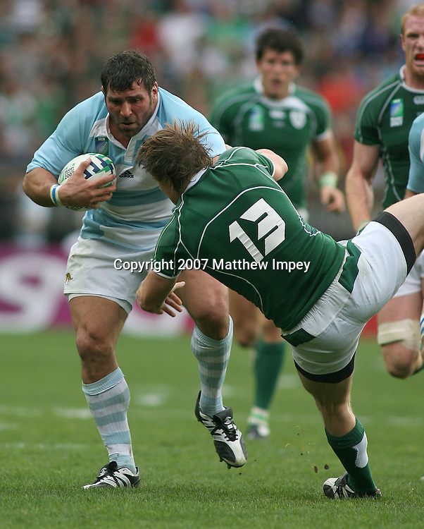 Juan Martin Scelzo of Argentina pushes away Brian O'Driscoll of Ireland. Ireland v Argentina, Rugby World Cup, Pool D, Rugby Union, Parc des Princes ,Paris, 30/09/2007. © Matthew Impey / Wiredphotos.co.uk . tel: 07789 130 347 e: matt@wiredphotos.co.uk