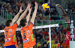 Matevz Kamnik and Alen Sket of ACH vs Rolando Jurquin Despaigne of Olympiacos during volleyball match between ACH Volley (SLO) and Olympiacos (GRE) in 4th Round of 2011 CEV Champions League, on December 14, 2010 in Arena Stozice, Ljubljana, Slovenia.  (Photo By Vid Ponikvar / Sportida.com)