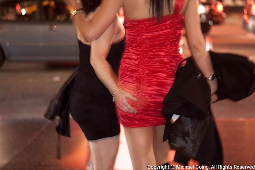 Young woman with hand on another's rear end New Years Eve in Hollywood
