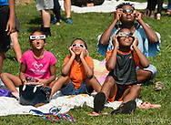 Middletown, New York - People gather on Alumni Green at SUNY Orange to watch a partial solar eclipse on Aug.21, 2017.