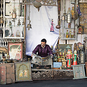 Man reading newspaper in his shop in Udaipur, Rajasthan