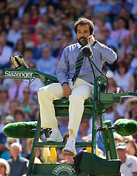 LONDON, ENGLAND - Thursday, July 3, 2014: Chair umpire Kader Nouni halts the game in the first set tie-break to call for medical assistant for a spectator who was taken ill during the Ladies' Singles Semi-Final match on day ten of the Wimbledon Lawn Tennis Championships at the All England Lawn Tennis and Croquet Club. (Pic by David Rawcliffe/Propaganda)