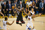 Houston Rockets guard James Harden (13) takes the ball to the basket against the Golden State Warriors at Oracle Arena in Oakland, Calif., on December 1, 2016. (Stan Olszewski/Special to S.F. Examiner)