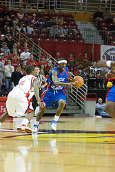 "02 December 2006: Rodrick Epps pushes as he passes Keith ""Boo"" Richardson. In a non-conference game, the Mavericks of University of Texas at Arlington lost to the Redbirds home 86-61. The win was the 5th in a row for the Redbirds, the longest winning streak in 6 years. the game was played at Redbird Arena in Normal Illinois on the campus of Illinois State University.<br />"