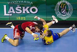 Laszlo Nagy of Veszprem fight for ball with  Alem Toskic of Celje during handball match between RK Celje Pivovarna Lasko (SLO) and MKB Veszprem KS (HUN) in 7th Round of Group B of EHF Champions League 2012/13 on December 1, 2012 in Arena Zlatorog, Celje, Slovenia. (Photo By Vid Ponikvar / Sportida)