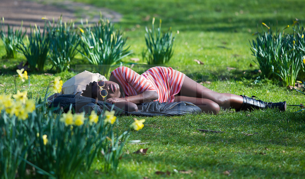 © Licensed to London News Pictures. 09/03/2014. Green Park, London. A woman enjoying the fine weather in Green Park as temperatures are forecast to reach up to 18 degress centigrade today. Photo credit : David Tett/LNP
